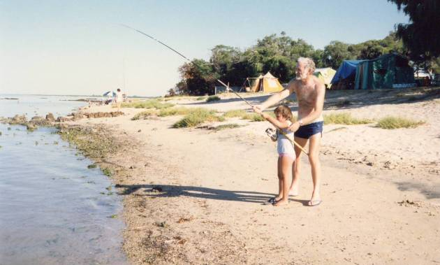 My sister, Claire, and Grandad fishing at our piece of beach (circa 1987)